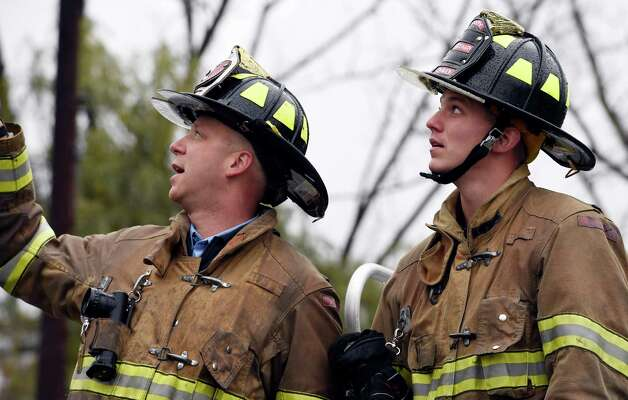 Troy Fire Department Lt. Matthew Dwon, left in the bucket,  works with probationary firefighters during training Thursday morning Oct. 23, 2014 at the Colonie Fire Training Center in Colonie, N.Y.   (Skip Dickstein/Times Union) Photo: SKIP DICKSTEIN / 00029087A