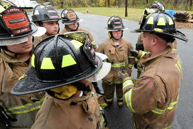 Troy Fire Department Lt. Matthew Dwon, right,  works with probationary firefighters during training Thursday morning Oct. 23, 2014 at the Colonie Fire Training Center in Colonie, N.Y.   (Skip Dickstein/Times Union) Photo: SKIP DICKSTEIN / 00029087A