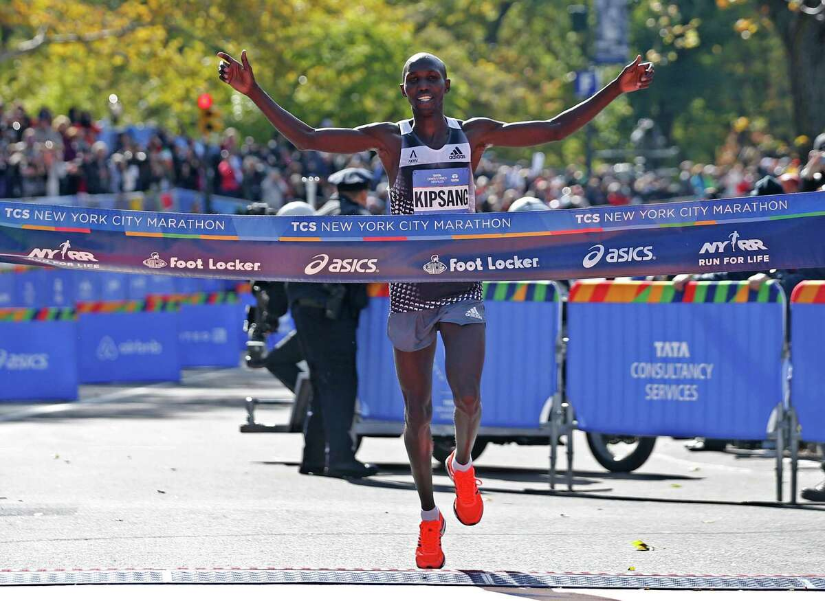 Wilson Kipsang of Kenya celebrates as he hits the tape to win the men's division of the the 44th annual New York City Marathon in New York, Sunday, Nov. 2, 2014. Kipsang won in an unofficial time of 2 hours, 10 minutes, 59 seconds. (AP Photo/Kathy Willens) ORG XMIT: NYKW108