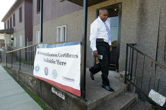 Delrick Brown leaves the Election Identification Certificates station at Holman Street Baptist Church after being told he needed more documents to get a photo ID to vote Tuesday.