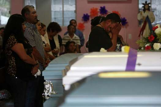 Juan Pablo Zapata grieves during the funeral for his cousins, Erica Alvarado Rivera, 26, Alex Alvarado, 22, and Jose Angel Alvarado, 21, at Nuestra Se–ora del Carmen Church in El Control, Mexico on Sunday, November, 2, 2014. The siblings, U.S. Citizens from Progreso, were found shot to death more than two weeks after they went missing from a restaurant near El Control. Photo: Lisa Krantz / SAN ANTONIO EXPRESS-NEWS