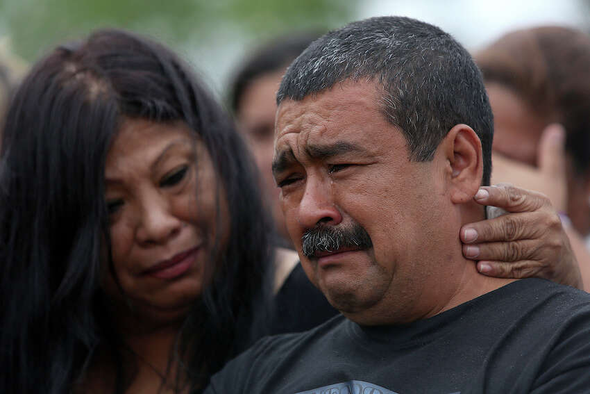 Pedro Alvarado is comforted during the burial of his children, Erica Alvarado Rivera, 26, Alex Alvarado, 22, and Jose Angel Alvarado, 21, in El Control, Mexico on Sunday, November, 2, 2014. The siblings, U.S. Citizens from Progreso, were found shot to death more than two weeks after they went missing from a restaurant near El Control.