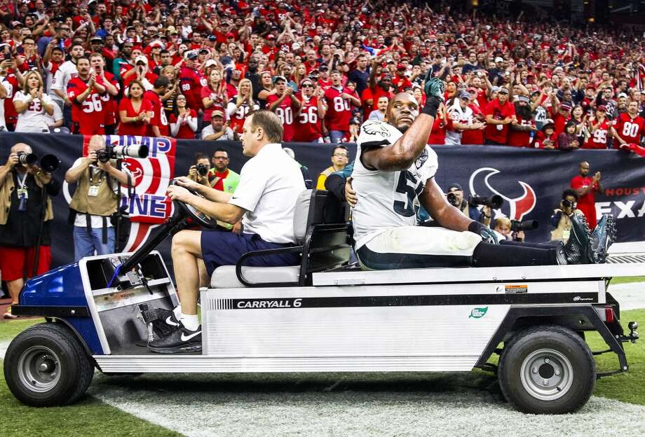 Eagles inside linebacker DeMeco Ryans waves to the crowd as he is carted off the field. Photo: Karen Warren, Houston Chronicle