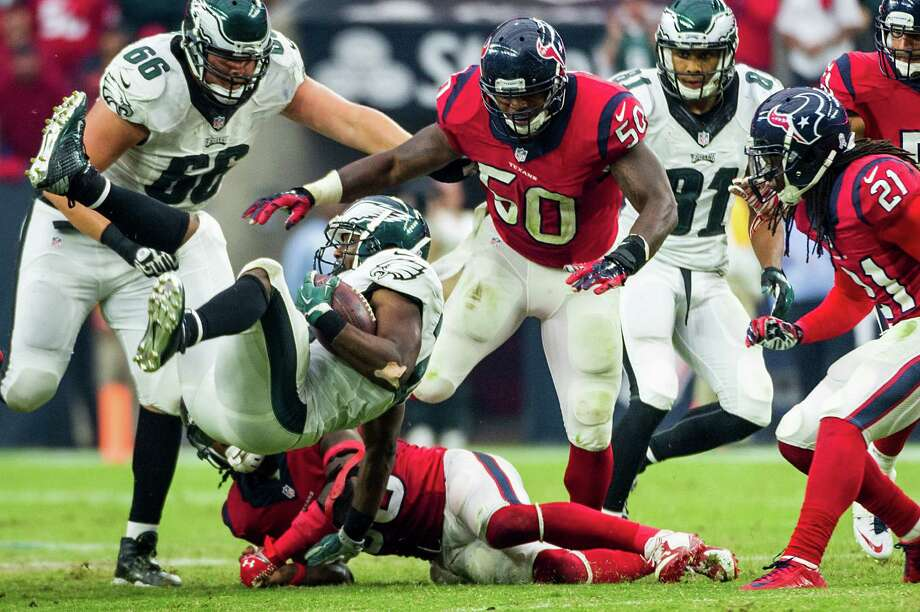 Eagles running back LeSean McCoy (25) is knocked off his feet by Texans safety D.J. Swearinger (36) in the second half. McCoy carried 23 times for 117 yards. Photo: Smiley N. Pool, Staff / © 2014  Houston Chronicle