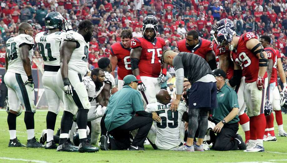 Eagles linebacker DeMeco Ryans (59) is comforted by injured Texans linebacker Brian Cushing, a former teammate of Ryans when both were with the Texans. Ryans reportedly suffered a torn right Achilles tendon on the play, although the Eagles haven't announced it. Photo: Karen Warren, Staff / © 2014 Houston Chronicle