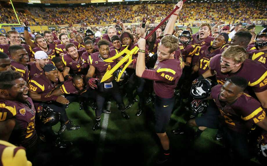After Arizona State beat Utah in overtime Saturday, Zane Gonzalez, who kicked the winning field goal, led the celebration. The next chore for the Sun Devils is trying to stick a fork in Notre Dame's playoff hopes this week. Photo: Ross D. Franklin, STF / AP