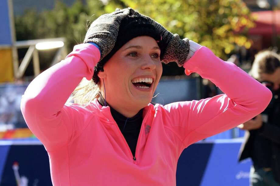 """Caroline Wozniacki surprised herself by making a smoother than expected transition from the tennis court to her first marathon, finishing in 3:27 on Sunday in New York. """"I'm so proud,"""" she said. """"Now I have this medal. I can say that I've done the New York City Marathon. I've even done it at a cool time. So I'm really, really happy."""" Photo: DON EMMERT, Staff / AFP"""