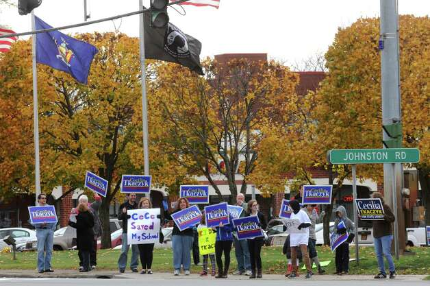 Supporters of State Senator Cecilia Tkaczyk take part in a Get-Out-The-Vote Rally infront of the Price Chopper on Saturday Nov. 1, 2014 in Guilderland, N.Y. (Michael P. Farrell/Times Union) Photo: Michael P. Farrell / 00029314A