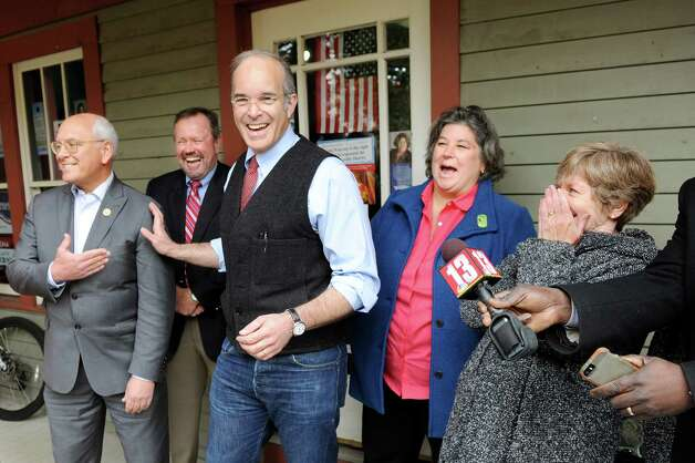 Aaron Woolf, candidate for the 21st District U.S. Congress, center, joins Rep. Paul Tonko, left, and other candidates for a Democratic rally on Saturday, Nov. 1, 2014, at Carrie Woerner's headquarters in Saratoga Springs, N.Y. Joining them is Brian Howard, 43rd District NYS Senate, second from left, Carrie Woerner, 113th District Assembly, second from right, and Madelyn Thorne, 49th District NYS Senate, right. (Cindy Schultz / Times Union) Photo: Cindy Schultz / 00029315A