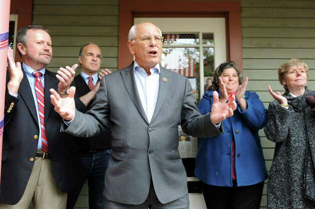 Rep. Paul Tonko, center, speaks during a Democratic rally on Saturday, Nov. 1, 2014, at candidate Carrie Woerner's headquarters in Saratoga Springs, N.Y. Joining him, from left, are candidates Brian Howard, Aaron Woolf, Carrie Woerner and Madelyn Thorne. (Cindy Schultz / Times Union) Photo: Cindy Schultz / 00029315A