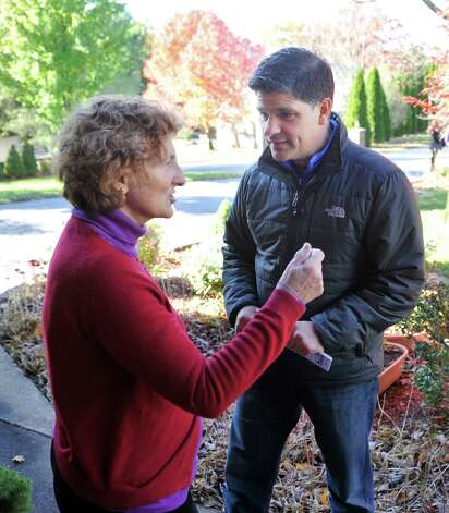 New York State Senate candidate George Amedore, right, talks with Cathy McGuire outside her home on Sunday, Nov. 2, 2014, in Guilderland, N.Y.  Amedore was going door to door in the neighborhood as he continues to campaign before election day.  (Paul Buckowski / Times Union) Photo: Paul Buckowski
