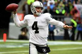 SEATTLE, WA - NOVEMBER 02:  Quarterback Derek Carr #4 of the Oakland Raiders throws the ball during the first quarter of the game against the Seattle Seahawks at CenturyLink Field on November 2, 2014 in Seattle, Washington.  (Photo by Steve Dykes/Getty Images)