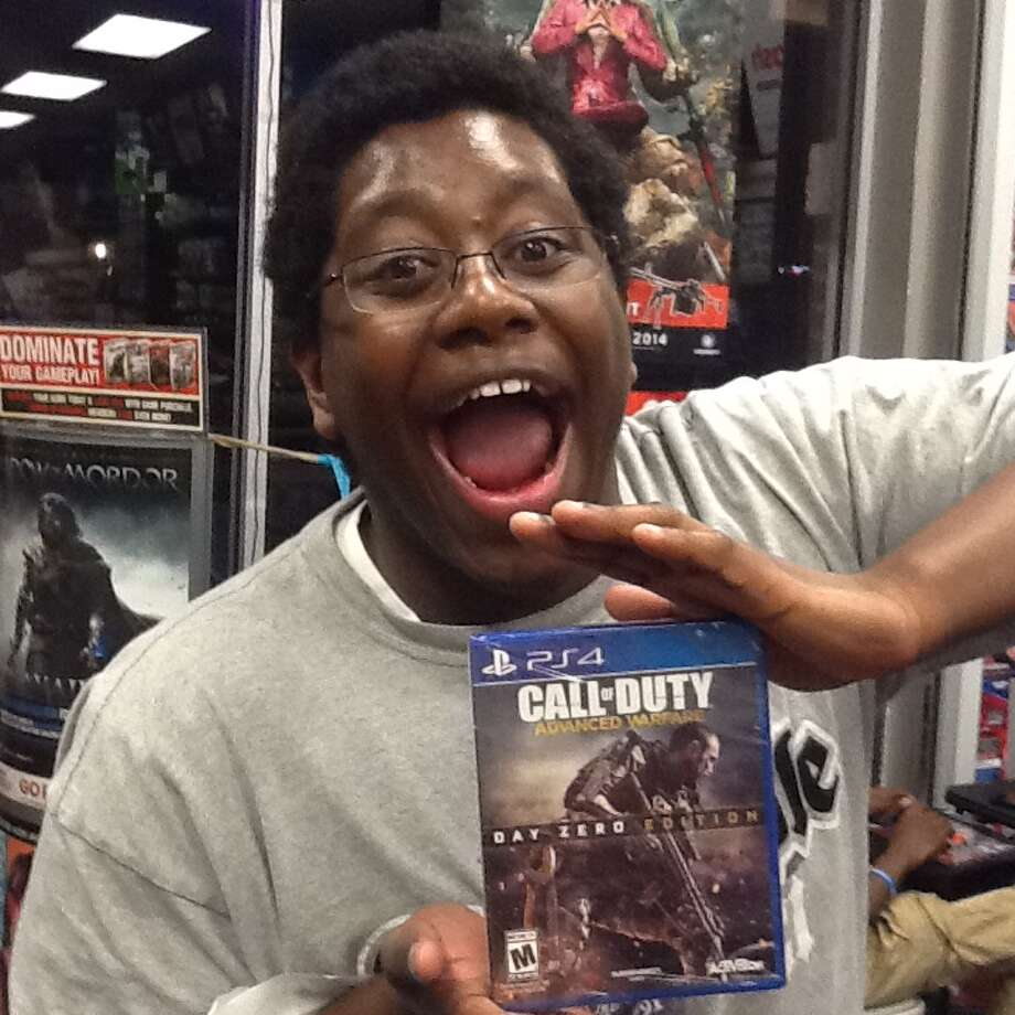 "Call of Duty faithful hit GameStop locations all around San Antonio Sunday evening in a lighting quick raid at pre-order release events to pick up their copies of the new ""Call of Duty: Advance Warfare."" These operatives and others like them across the U.S. will be the first wave of fans to play the game as it releases to the general public on Tuesday. Photo: Chris Quinn"