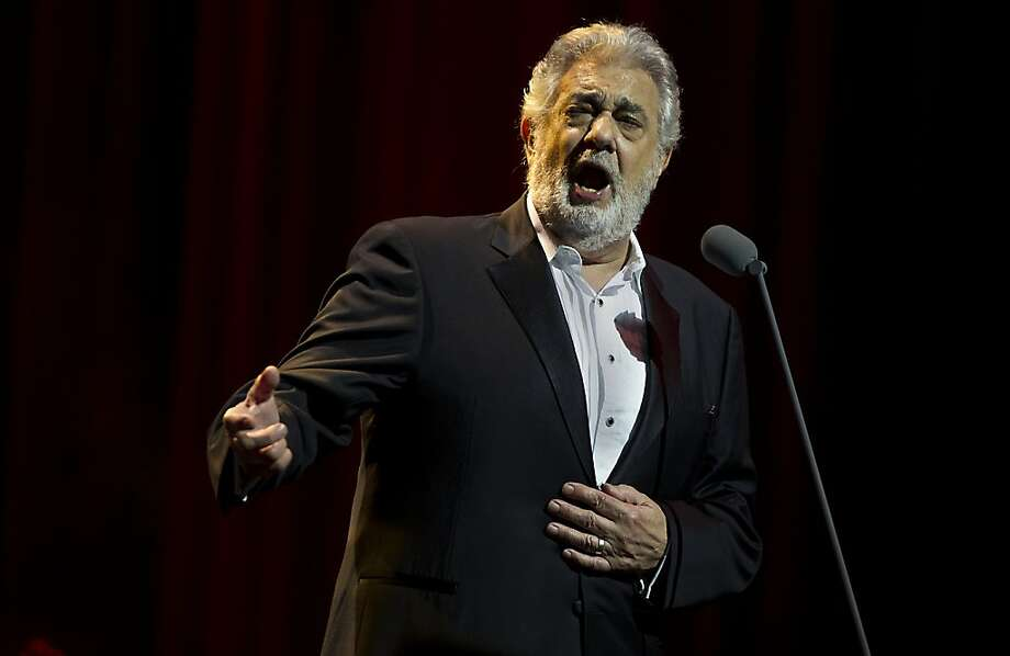 Spanish tenor and conductor Placido Domingo sings during a concert in the Ziggodome in Amsterdam, The Netherlands, on June 13, 2013.  AFP PHOTO / ANP / PAUL BERGEN 