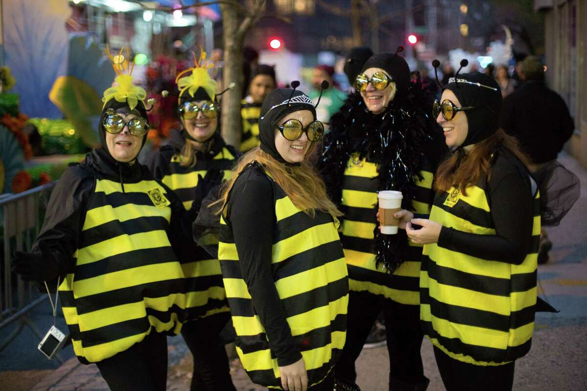 NEW YORK, NY - OCTOBER 31: Revelers dressed as bees gathered ahead of the 41st Annual Village Halloween Parade October 31, 2014 in New York City. Thousands of costumed New Yorkers gather every year at the parade, which starts on Spring Street before heading more than a mile along Sixth Avenue. (Photo by Kevin Hagen/Getty Images) ORG XMIT: 521269297