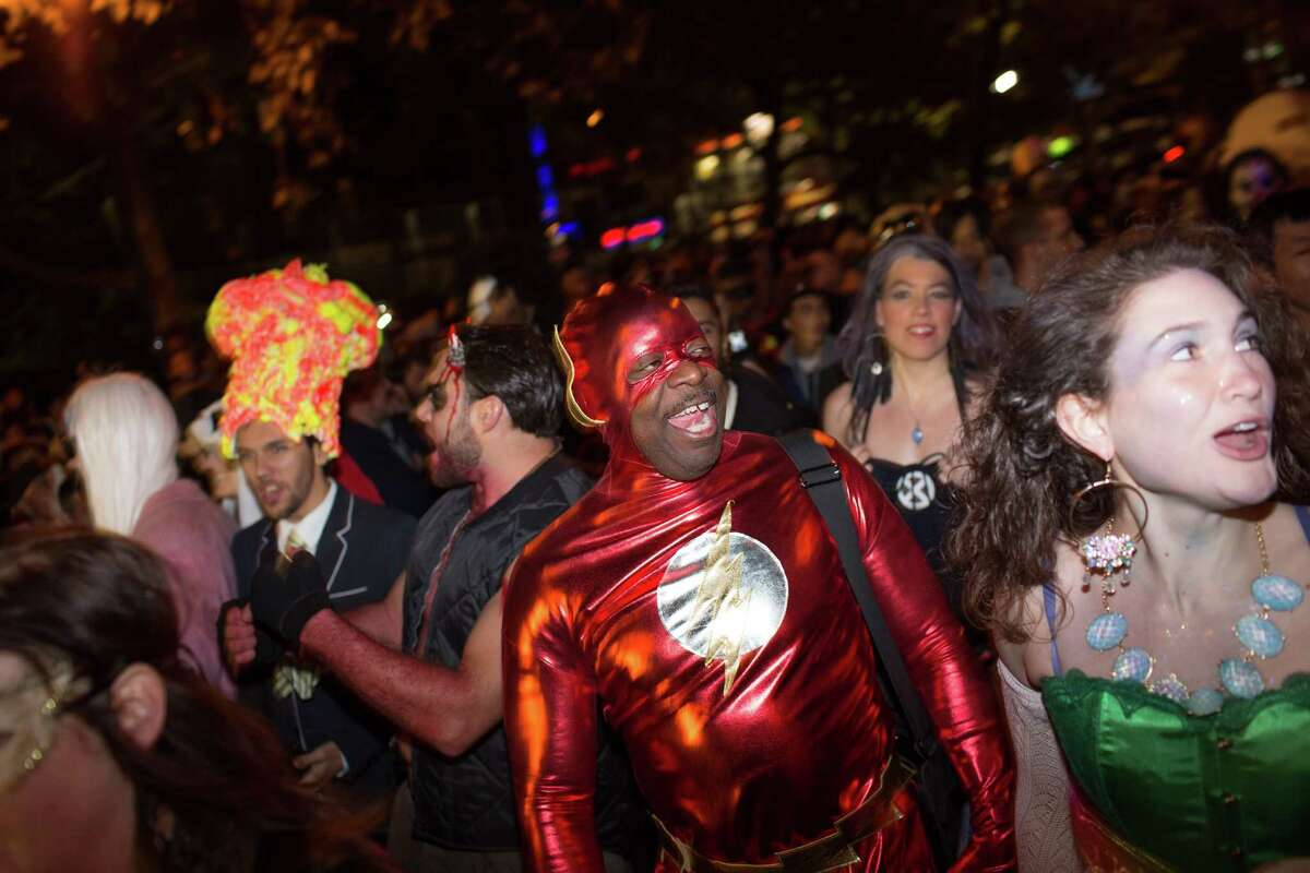 NEW YORK, NY - OCTOBER 31: Walter Goolsby, dressed as superhero the Flash, shouts with the crowd during the 41st Annual Village Halloween Parade October 31, 2014 in New York City. Thousands of costumed New Yorkers gather every year at the parade, which starts on Spring Street before heading more than a mile along 6th Avenue. (Photo by Kevin Hagen/Getty Images) ORG XMIT: 521269297