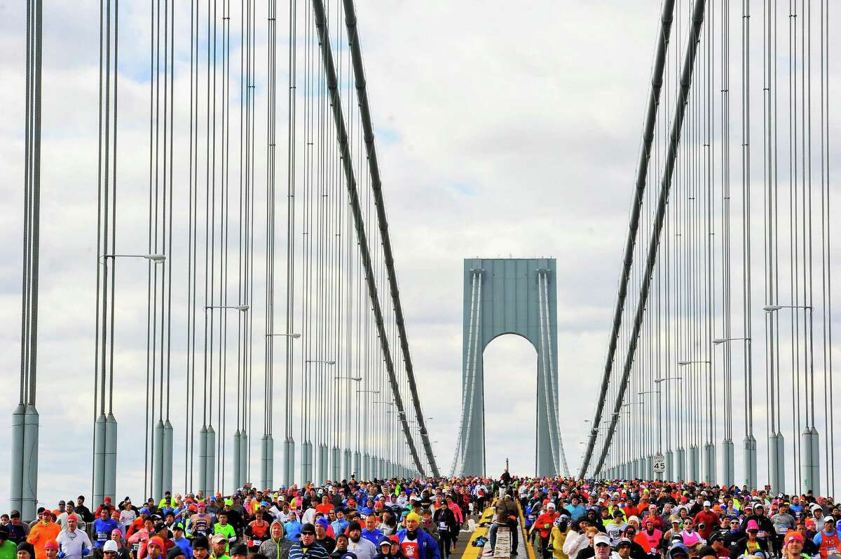 NEW YORK, NY - NOVEMBER 02: Runners cross the Verrazano-Narrows Bridge at the start of the TCS New York City Marathon on November 2, 2014 in the Brooklyn borough of New York City. (Photo by Alex Goodlett/Getty Images) *** BESTPIX *** ORG XMIT: 516365725