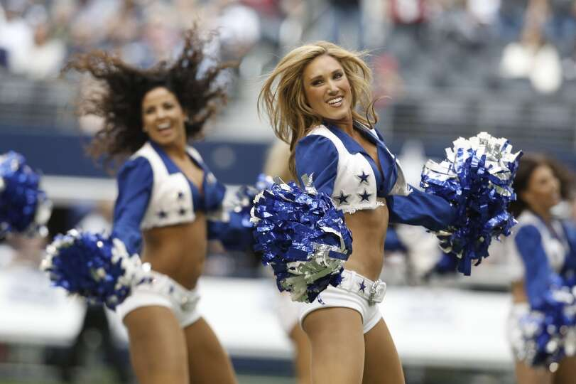 The Dallas Cowboys Cheerleaders perform during the first half of an NFL football game against the Ar