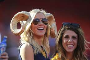 St. Louis Rams fans smile before an NFL football game against the Kansas City Chiefs in Kansas City, Mo., Sunday, Oct. 26, 2014. (AP Photo/Ed Zurga)