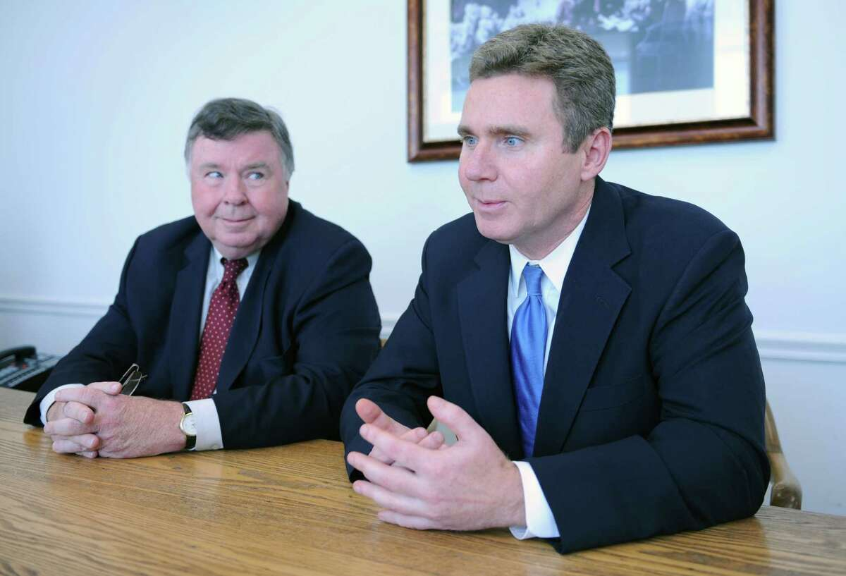 Gerald Fox III, right, talks beside his father Gerald Fox Jr. in the probate office at the Stamford Government Center in Stamford, Conn. Monday, Nov. 3, 2014. Fox III is vying to get elected as probate judge, taking over a position held by his father for many years.