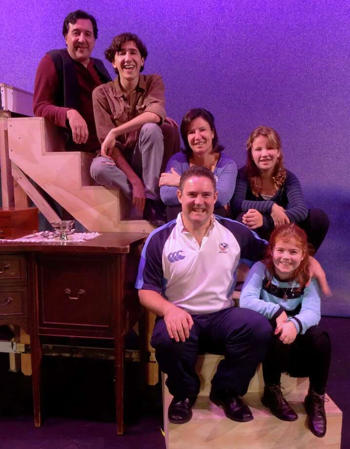 "In Curtain Call's production of ""Meet Me in St. Louis""  three parent and child combinations appear together, including father and son, Bill and Levi Squier (at top of stairs) who are playing father and son on stage. Also appearing are mother and daughter Robie and Poppy Livingstone (middle couple on stairs) and father and daughter Nick and Katie Priscott ( bottom steps). Photo: Contributed Photo / Connecticut Post Contributed"