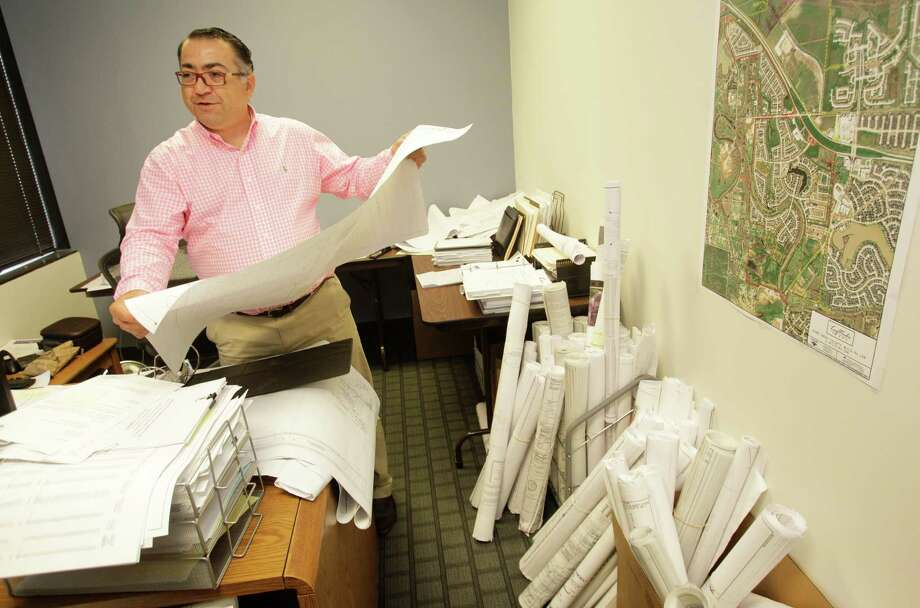 Alex Khoshakhlagh, a project engineer, is shown in his office at Costello, 9990 Richmond Ave., Thursday, Sept. 25, 2014, in Houston. Photo: Melissa Phillip, Houston Chronicle / © 2014  Houston Chronicle