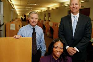 ECFMG Executive Director Dr. Kim Edward LeBlanc left, Center Manager Sandie Pullen center, and Assistant Center Manager Forest Roberts right, pose for a portrait ECFMG, which is a testing center for medical students Wednesday, Oct. 8, 2014, in Houston.