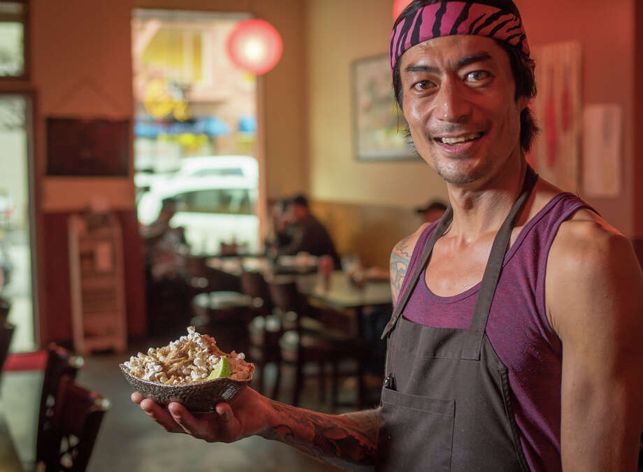 Chef Jesse Koide with the Hurricane Popcorn & Pig Ears at Pink Zebra restaurant in San Francisco. Photo: John Storey / Special To The Chronicle / ONLINE_YES
