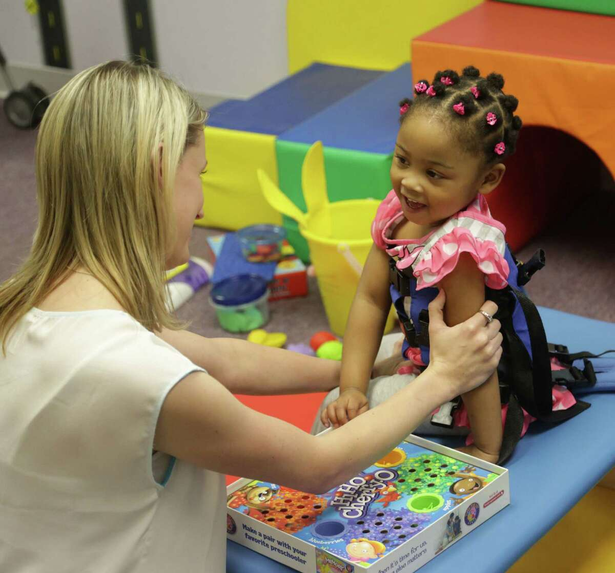 Minnie Baker works with patient Latiya Hadnot at Cole Pediatric Therapy in Conroe. e.