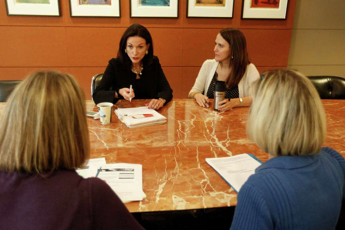 PKF partner Karen Love, left, conducts a meeting with associates on Monday, Oct. 6, 2014, in Houston . PKF has been named one of the top workplaces in Houston.