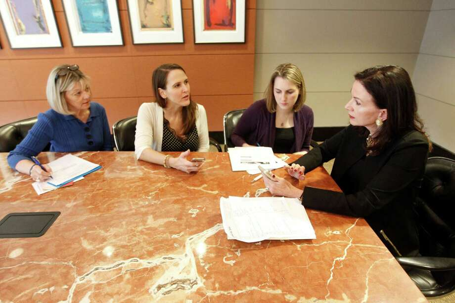 PKF partner Karen Love, right, meets with associates, from left, Cindy 