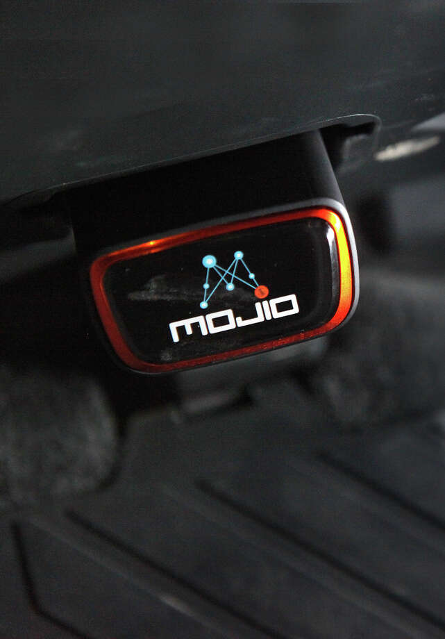 Mojio, which connnects even older cars to a wealth of information, plugs in to the dashboard data port. Photo: Liz Hafalia / The Chronicle / ONLINE_YES