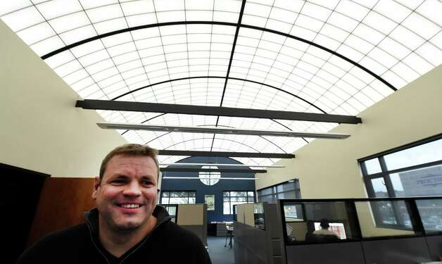 J.T. Pollard strands underneath the fiberglass ceiling at his workplace Re4orm Architecture Wednesday morning Oct. 22, 2014 in Schenectady, N.Y.      (Skip Dickstein/Times Union) Photo: SKIP DICKSTEIN / 00029124A