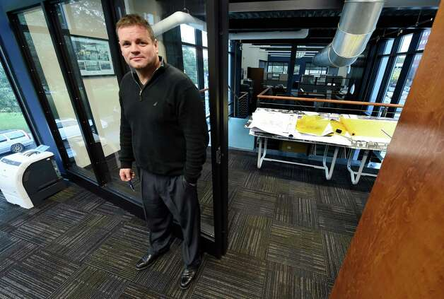 J.T. Pollard stands at the entrance of his office at Re4orm Architecture Wednesday morning Oct. 22, 2014 in Schenectady, N.Y.      (Skip Dickstein/Times Union) Photo: SKIP DICKSTEIN / 00029124A