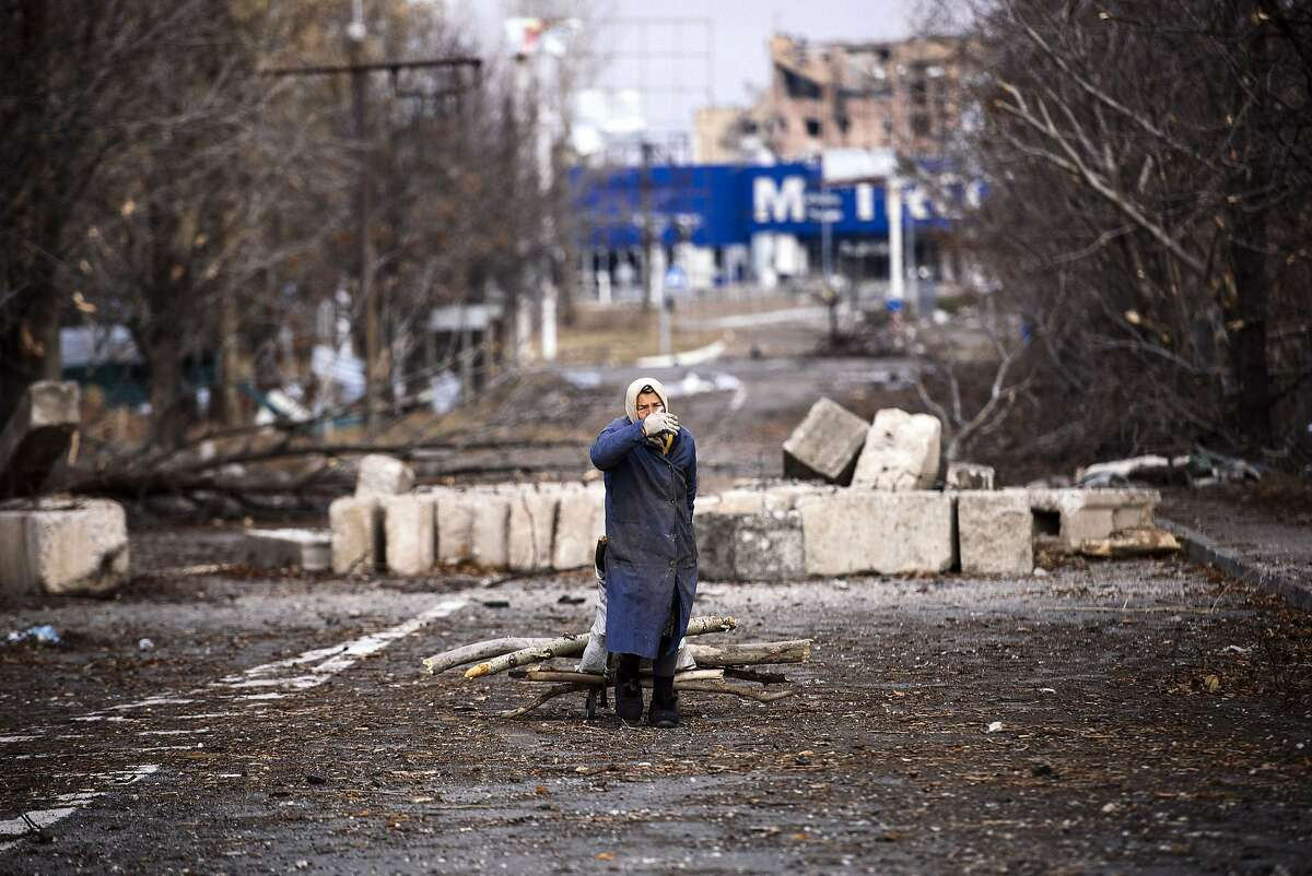 TOPSHOTS An elderly woman pulls a cart with firewood near the Donetsk airport, in eastern Ukraine on November 3, 2014. EU foreign policy chiefs blasted Moscow's recognition of separatist elections in Ukraine on November 3, saying the polls, which sought to put a legal veneer on the bloody pro-Russian rebellion, violated a peace agreement. AFP PHOTO / DIMITAR DILKOFFDIMITAR DILKOFF/AFP/Getty Images
