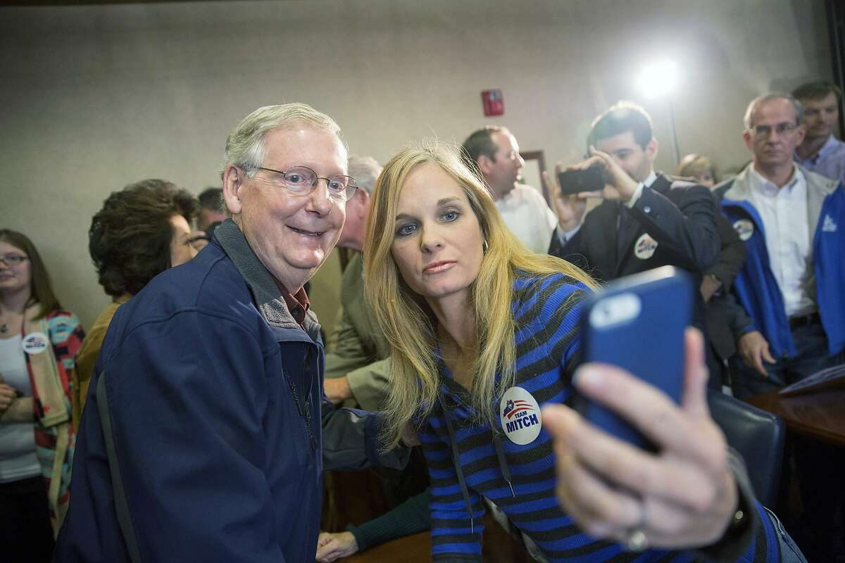 LEXINGTON, KY - NOVEMBER 3: U.S. Sen. Mitch McConnell (R-KY) (L) takes a photo with a supporter following an election rally at Bluegrass Airport November 3, 2014 in Lexington, Kentucky. Heading into election day McConnell remains in a close race with Kentucky Secretary of State Alison Lundergan Grimes. (Photo by Aaron P. Bernstein/Getty Images) *** BESTPIX ***