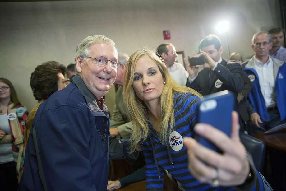 LEXINGTON, KY - NOVEMBER 3:   U.S. Sen. Mitch McConnell (R-KY) (L) takes a photo with a supporter following an election rally at Bluegrass Airport November 3, 2014 in Lexington, Kentucky.  Heading into election day McConnell remains in a close race with Kentucky Secretary of State Alison Lundergan Grimes. (Photo by Aaron P. Bernstein/Getty Images) *** BESTPIX *** Photo: Aaron P. Bernstein, Getty Images