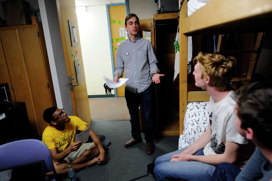 Berkeley City Council candidate Sean Barry (center) talks with UC Berkeley students D'mani Thomas (left), Nicholas Murphy and Justin Night in the Spens-Black Hall dorms while campaigning on campus. Photo: Michael Short / Special To The Chronicle / ONLINE_YES
