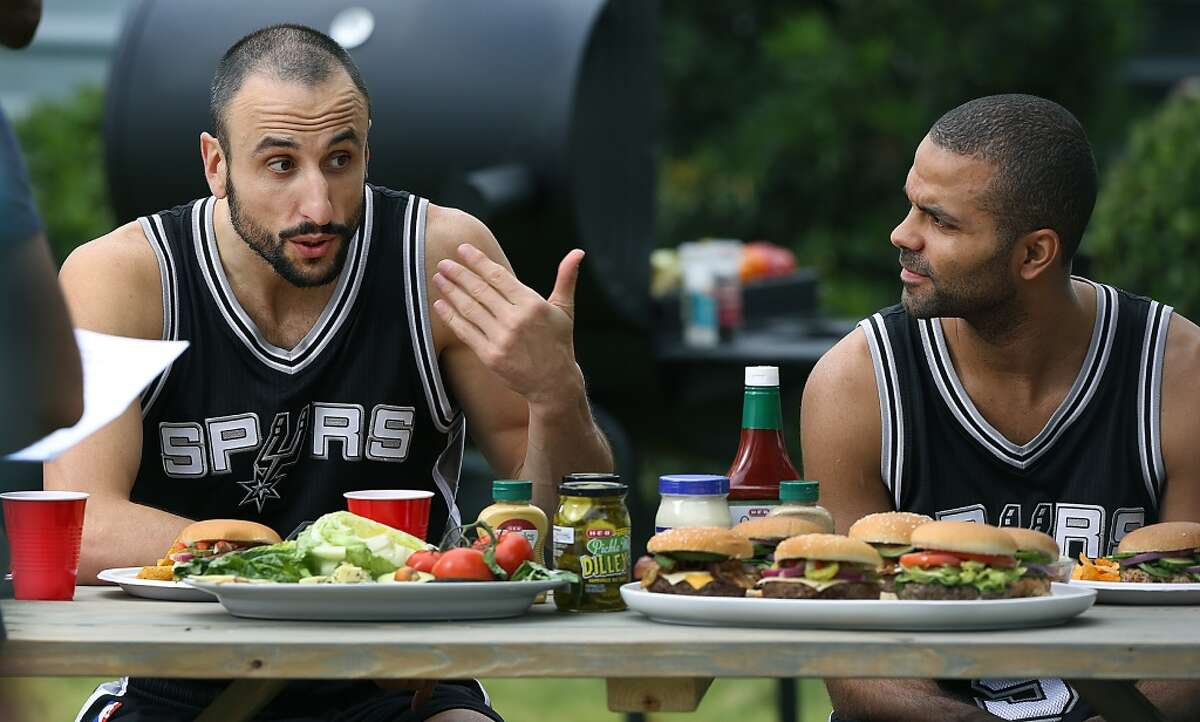 Spurs stars are often featured in H-E-B commercials click ahead for scenes from previous shoots. San Antonio Spurs Manu Ginobili, left, and Tony Parker rehearse lines during production of new HEB commercials, being filmed outside the NBA Champion's practice facility. Monday, Nov. 3, 2014.