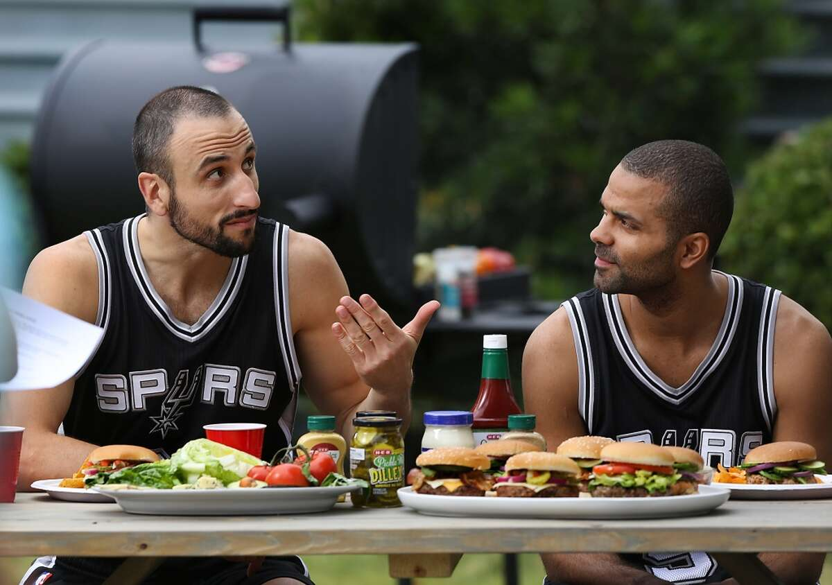 San Antonio Spurs Manu Ginobili, left, and Tony Parker rehearse lines during production of new HEB commercials being filmed outside the NBA Champion's practice facility. Monday, Nov. 3, 2014.