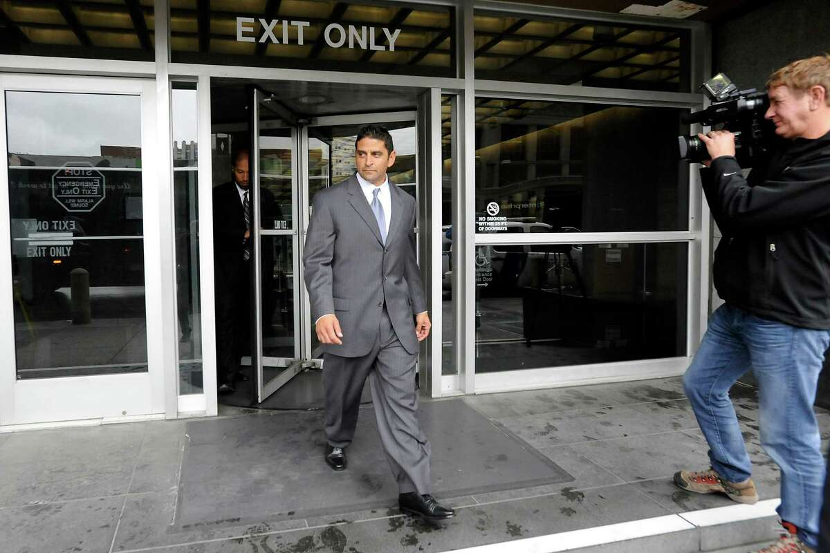 Indicted SF Police Officer Edmond Robles leaves the Federal Courthouse following their arraignment, in San Francisco, CA Friday, February 28, 2014.