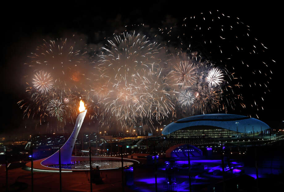 Fireworks glowed at the opening ceremony  Fireworks are seen over the Olympic Park during the opening ceremony of the 2014 Winter Olympics in Sochi, Russia, Friday, Feb. 7, 2014. (AP Photo/Julio Cortez) Photo: Julio Cortez / Associated Press / AP