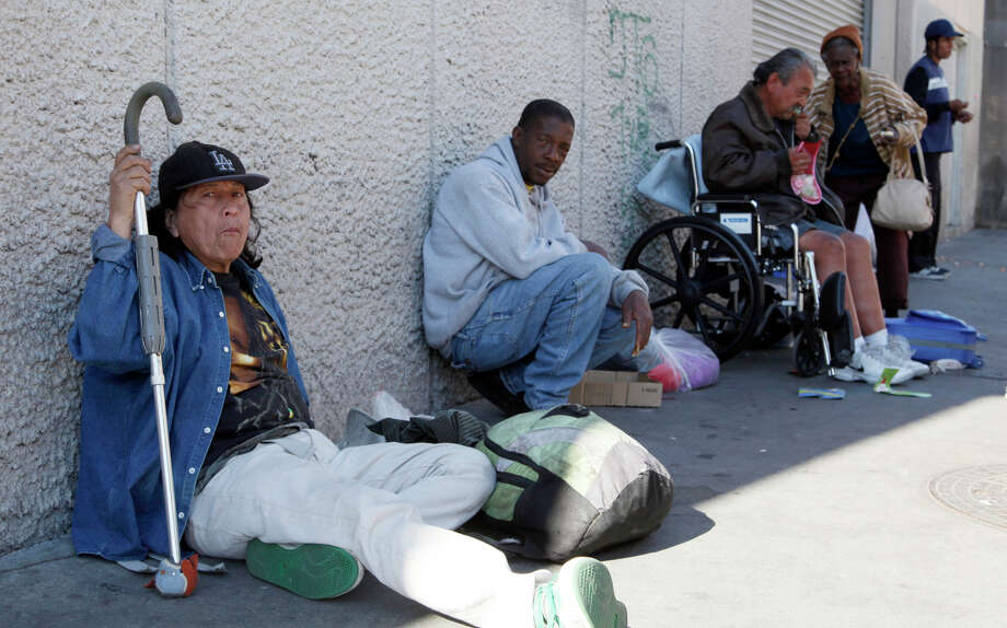 Homeless people line a sidewak in downtown Los Angeles. This population has a much higher incidence of many illnesses than the general public in both the United States and Europe, as reported in the Lancet. Photo: Nick Ut / Associated Press / AP