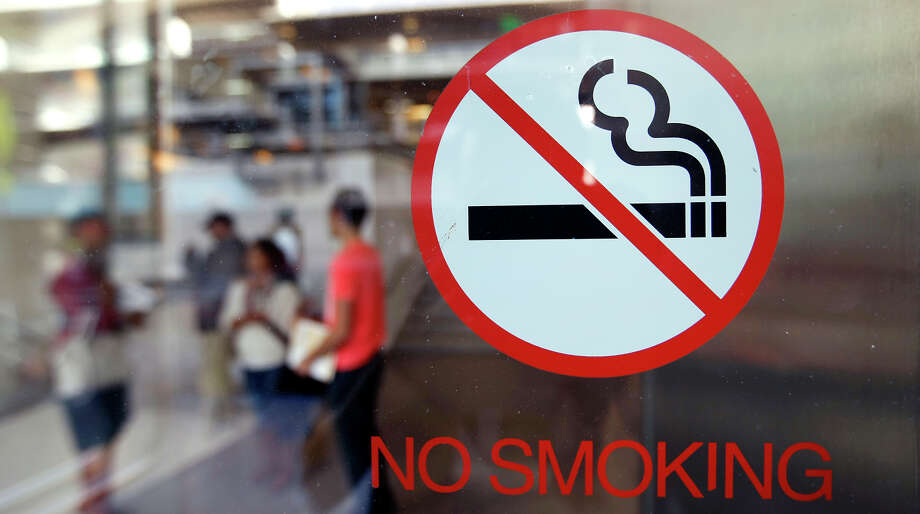 No-smoking signs are seen at the entrance to Berkeley City College. While the state has been a leader in instituting policies to reduce smoking, other states are rapidly making up ground. Photo: Michael Short / The Chronicle / ONLINE_YES