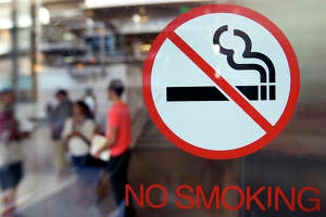 No-smoking signs are seen at the entrance to Berkeley City College. While the state has been a leader in instituting policies to reduce smoking, other states are rapidly making up ground.