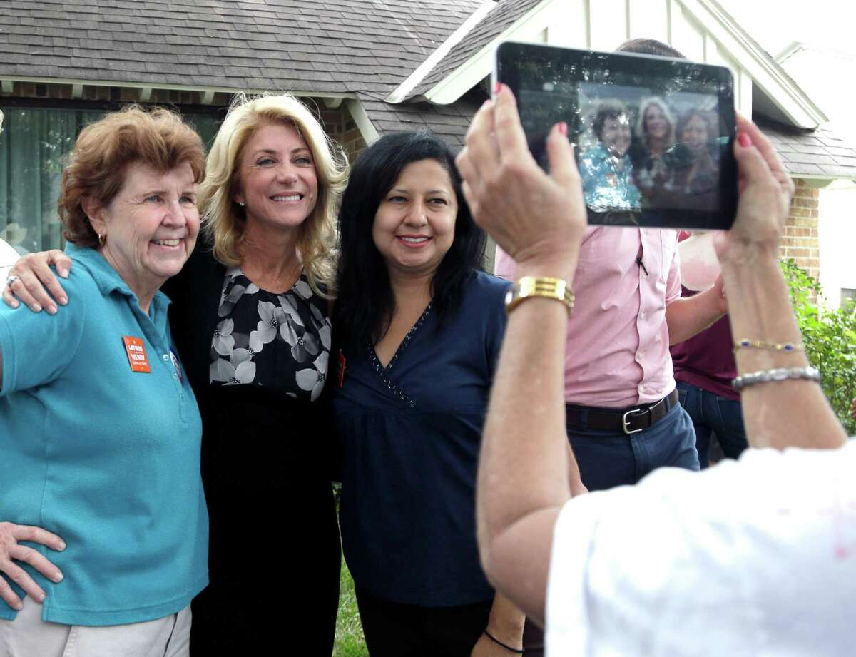 Democratic gubernatorial candidate Wendy Davis takes a photo with supporters in Houston on Monday.