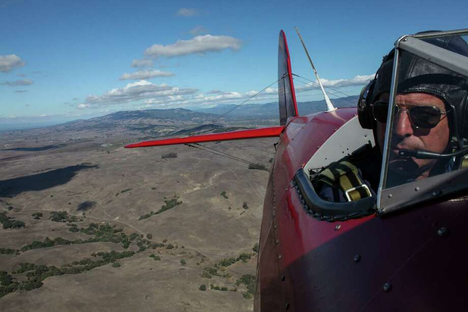 Pilot Chris Prevost flies over Sonoma in a Boeing-Stearman. The Sonoma Valley Airport allows people to take flights over Sonoma in vintage airplanes. Photo: Sam Wolson / Special To The Chronicle / ONLINE_YES