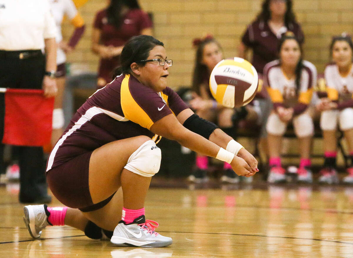 Handandale libero Dominique Delgado digs the ball during the Indians' match with McCollum at Harlandale on Oct. 28. McCollum won and is in the playoffs for the first time since 2010.