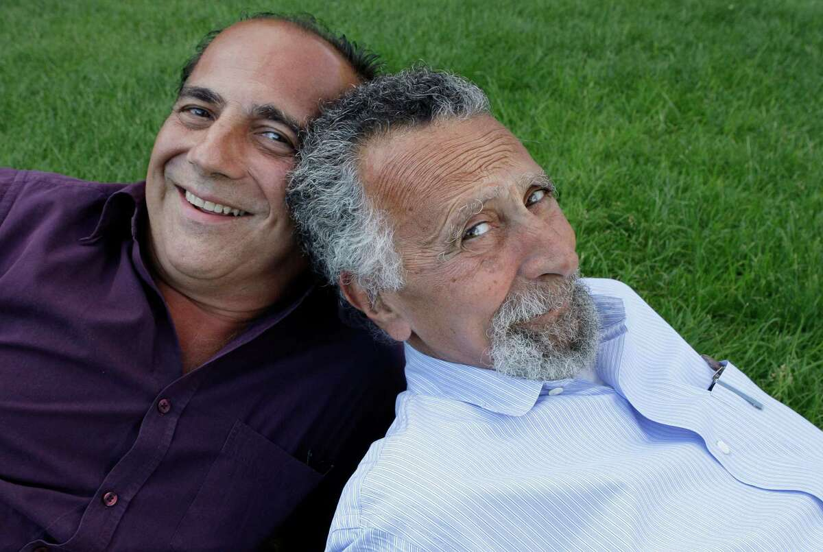 """In this June 19, 2008 photo, brothers Ray, left, and Tom Magliozzi, co-hosts of National Public Radio's """"Car Talk"""" show, pose for a photo in Cambridge, Mass. NPR says Tom Magliozzi died Monday, Nov. 3, 2014 of complications from Alzheimer's disease. He was 77."""