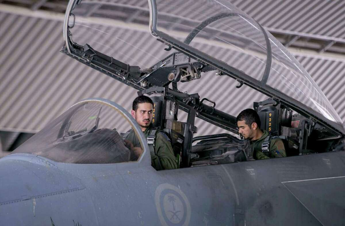 FILE - In this file photo released Wednesday, Sept. 24, 2014 by the official Saudi Press Agency, Saudi pilots sits in the cockpit of a fighter jet as part of U.S.-led coalition airstrikes on Islamic State militants and other targets in Syria that began early Tuesday in Saudi Arabia. U.S. Arab allies Egypt, Saudi Arabia, the United Arab Emirates and Kuwait are discussing creation of a military pact to take on Islamic militants, with the possibility of a joint force to intervene around the Middle East, The Associated Press has learned. Even if no joint force is agreed on, the alliance would coordinate military action, aiming at quick, pinpoint operations against militants rather than longer missions, officials said. (AP Photo/Saudi Press Agency, File) ORG XMIT: CAI302